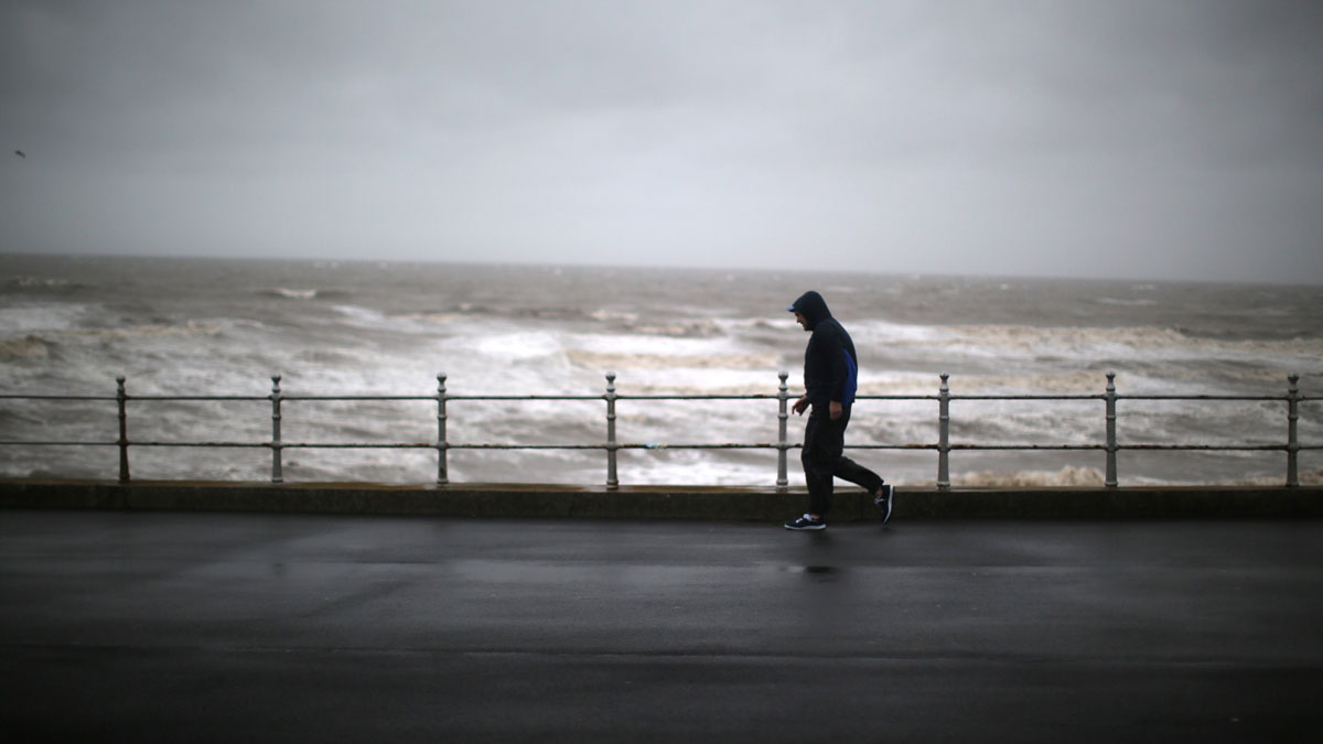 A man battles against driving rain and high winds in Blackpool, as Britain's first ever named storm, Storm Abigail, hits the North West on November 9, 2015 in Blackpool, England. The new naming system was introduced in September by the Met Office. To qualify for a name, the stormy weather must have the potential to cause medium or high wind impacts.