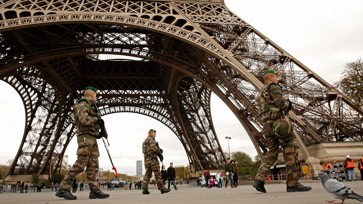 Members of the French Foreign Legion guard near the Eiffel Tower on Monday, Nov. 16, 2015.