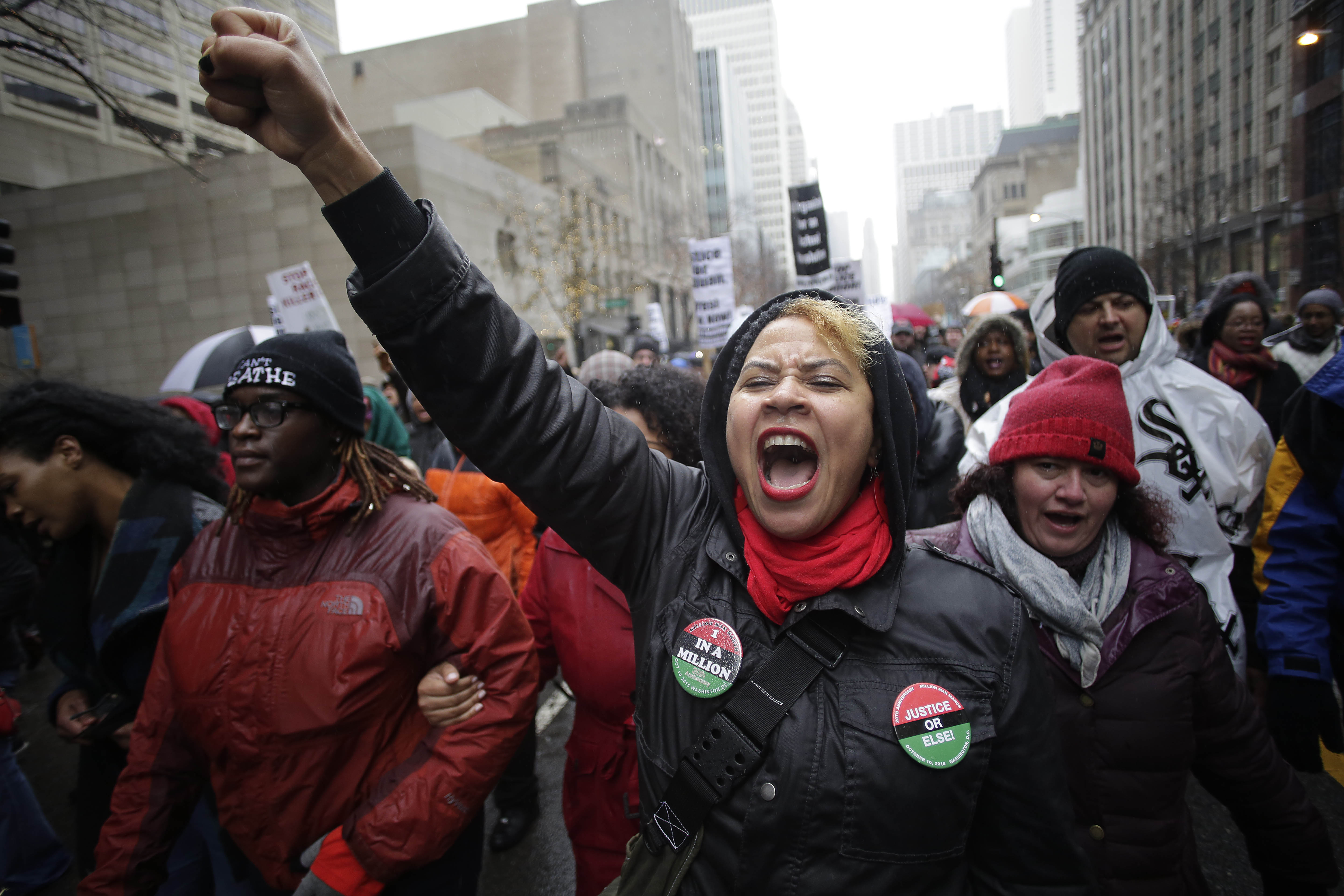 CHICAGO, IL - NOVEMBER 27: Demonstrators protest the shooting of Laquan McDonald along the Magnificent Mile November 27, 2015 in Chicago, Illinois. Chicago police officer Jason Van Dyke was charged Tuesday with first degree murder for fatally shooting 17-year-old McDonald 16 times last year on the southwest side of Chicago after Van Dyke was responding to a call of a knife wielding man. The dash-cam video of officer Van Dyke shooting McDonald was released by the Chicago Police department earlier this week after a judge denied Van Dyke bail during his bond hearing at Leighton Criminal Court. (Photo by Joshua Lott/Getty Images)