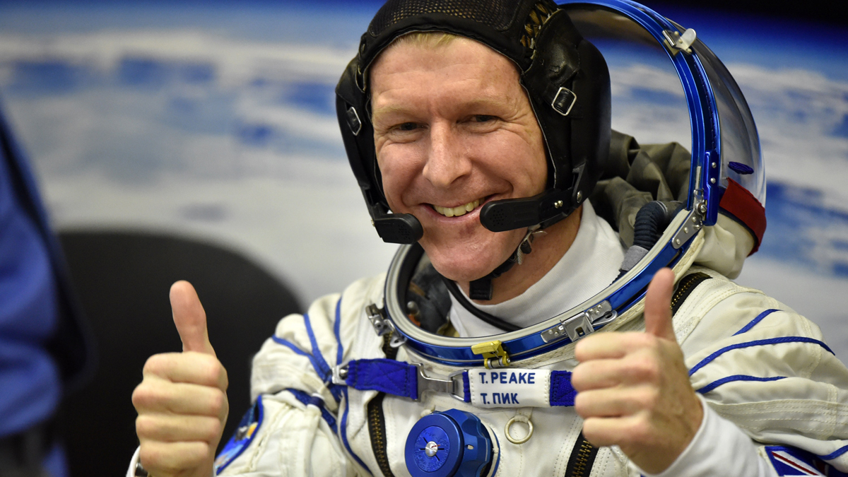 British astronaut Tim Peake gestures as his space suit is tested at the Russian-leased Baikonur cosmodrome, prior to blasting off to the International Space Station (ISS), on Dec. 15, 2015.