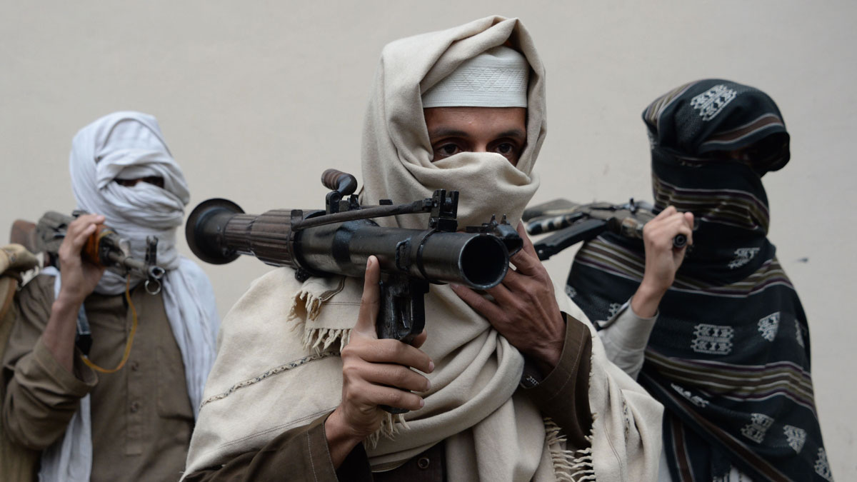 File Photo: Former Afghan Taliban fighters carry their weapons before handing them over as part of a government peace and reconciliation process at a ceremony in Jalalabad on Jan. 12, 2016.