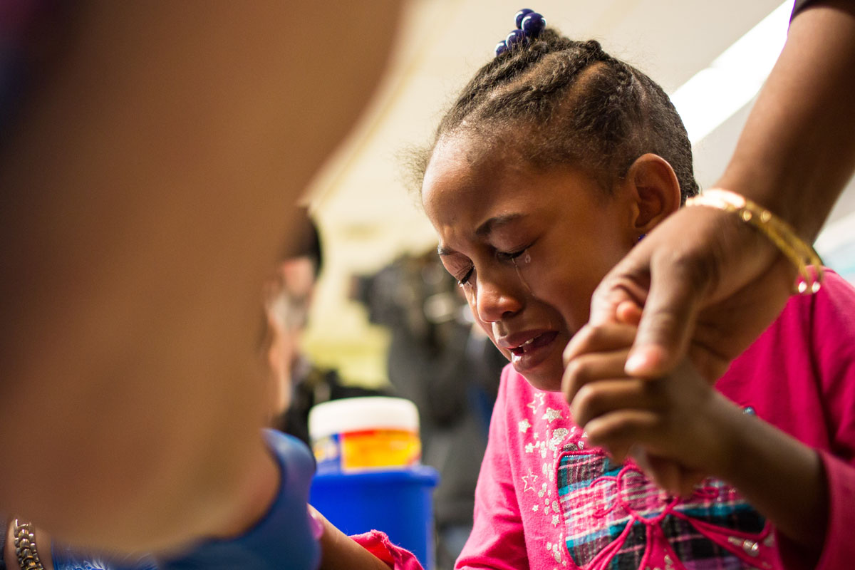 Tears stream down the face of Flint resident Morgan Walker, 5, as she gets her finger pricked for a lead screening on Jan. 26, 2016, at Eisenhower Elementary School in Flint, Michigan. Free lead screenings are performed for Flint children 6-years-old and younger, one of several events sponsored by Molina Healthcare following the city's water contamination and federal state of emergency.