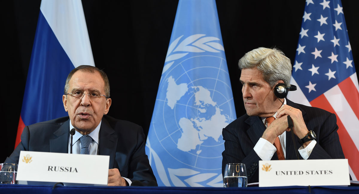 Russian Foreign Minister Sergei Lavrov speaks beside of US Secretary of States John Kerry during a news conference after the International Syria Support Group (ISSG) meeting in Munich, southern Germany, on February 12, 2016.