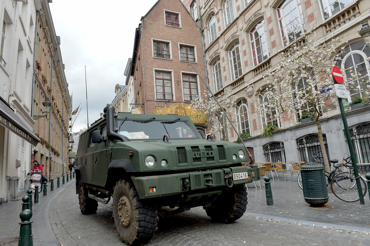Belgian Army Trucks are seen in the streets on March 23, 2016, in Brussels, Belgium. Belgium is observing three days of national mourning after more than 30 people were killed in a twin suicide blast at Zaventem Airport and a further bomb attack at Maelbeek Metro Station.