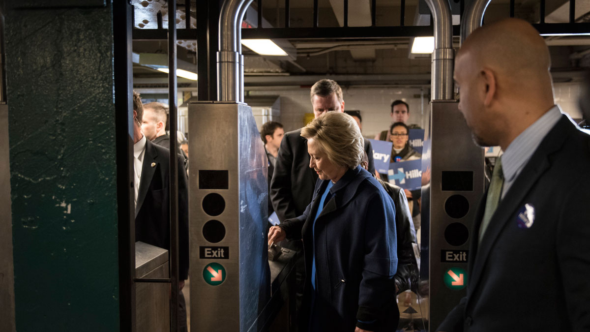 Hillary Clinton swipes a MetroCard to ride the No. 4 train as she campaigns on April 7, 2016, in the Bronx.