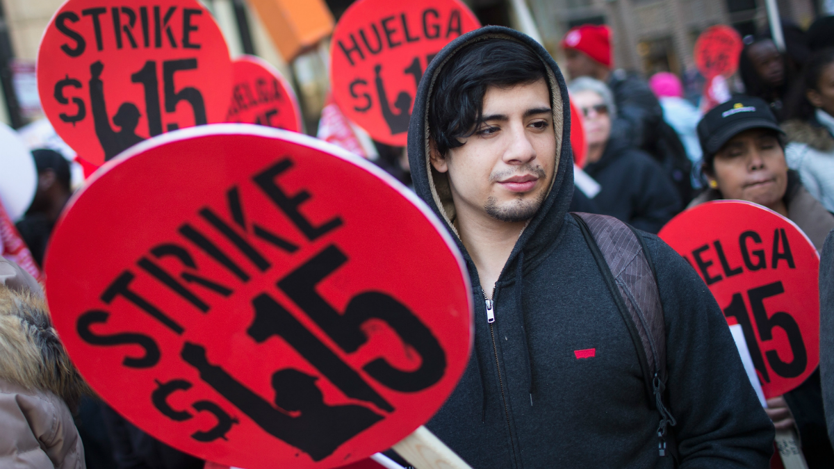 Demonstrators demanding an increase in the minimum wage to $15-dollars-per-hour prepare to march in the streets on April 14, 2016 in Chicago, Illinois. The demonstrators marched to and protested in front of several locations during a day-long effort to draw attention to low-wage jobs. The demonstration was one of about 300 scheduled to take place nationwide today.