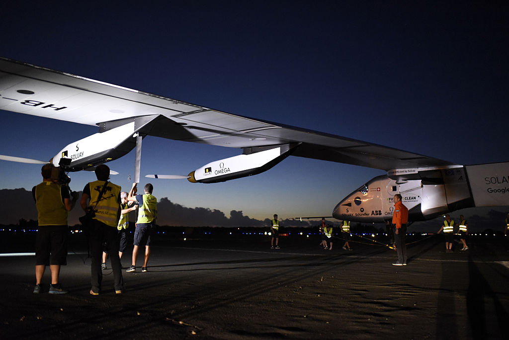 In this handout image supplied by Solar Impulse 2/GNR, team members are working on the plane short before