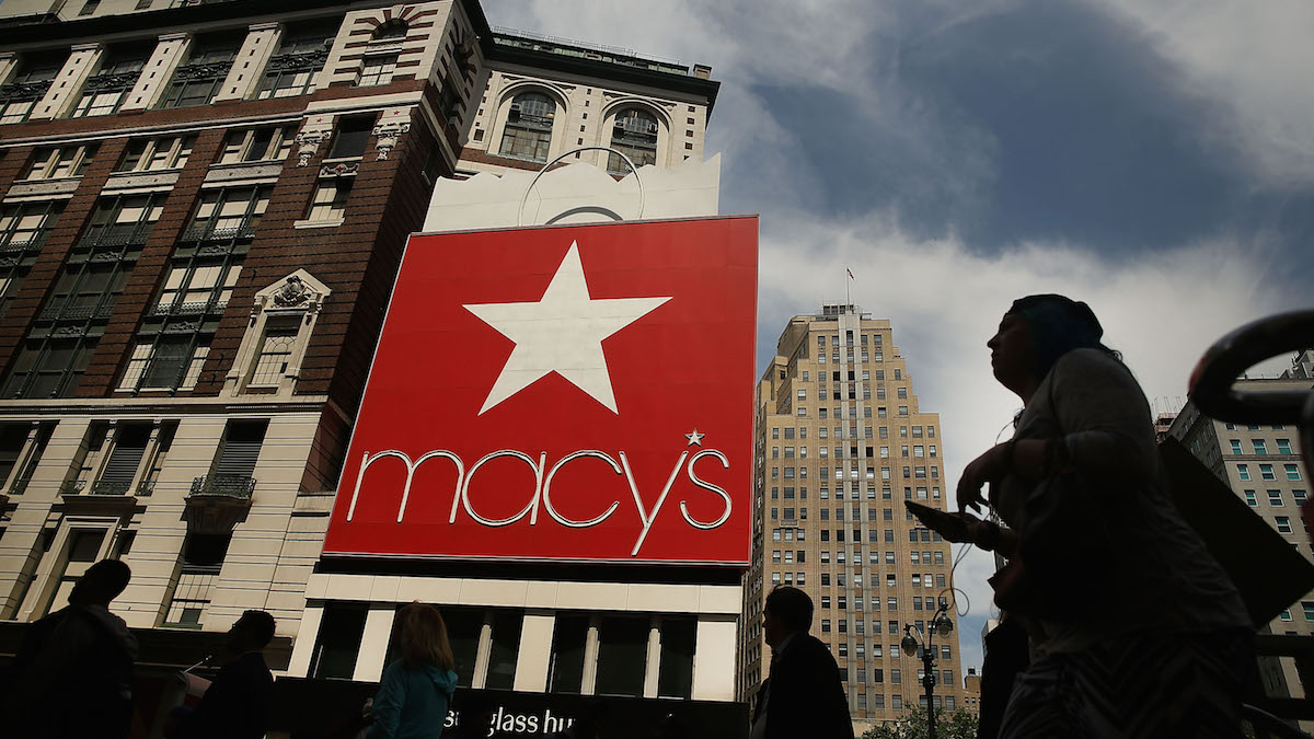 In this file photo, pedestrians walk by Macy's flagship store in Herald Square on May 11, 2016 in New York, New York.