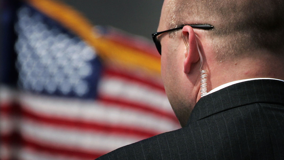 In this file photo, a Secret Service agent stands before the arrival of U.S. President George W. Bush at Prestwick Airport July 6, 2005 in Prestwick, Scotland. Homeland Secretary Secretary Jeh Johnson has authorized Secret Service protection for GOP presidential candidates Donald Trump and Ben Carson.