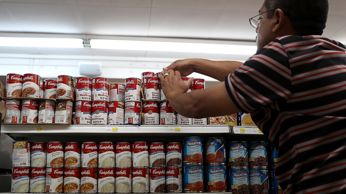 SAN RAFAEL, CA - MAY 20: A worker arranges cans of Campbell's soup on a supermarket shelf on May 20, 2016 in San Rafael, California. Campbell Soup Co. narrowly beat analysts expectations with third quarter earnings of $185 million, or 59 cents a share, compared to $179 million, or 57 cents a share, one year ago. The company also increased outlook for the year with adjusted per-share earnings of $2.93 to $3 a share instead of its previous guidance for $2.88 to $2.96 per shaere. (Photo by Justin Sullivan/Getty Images)
