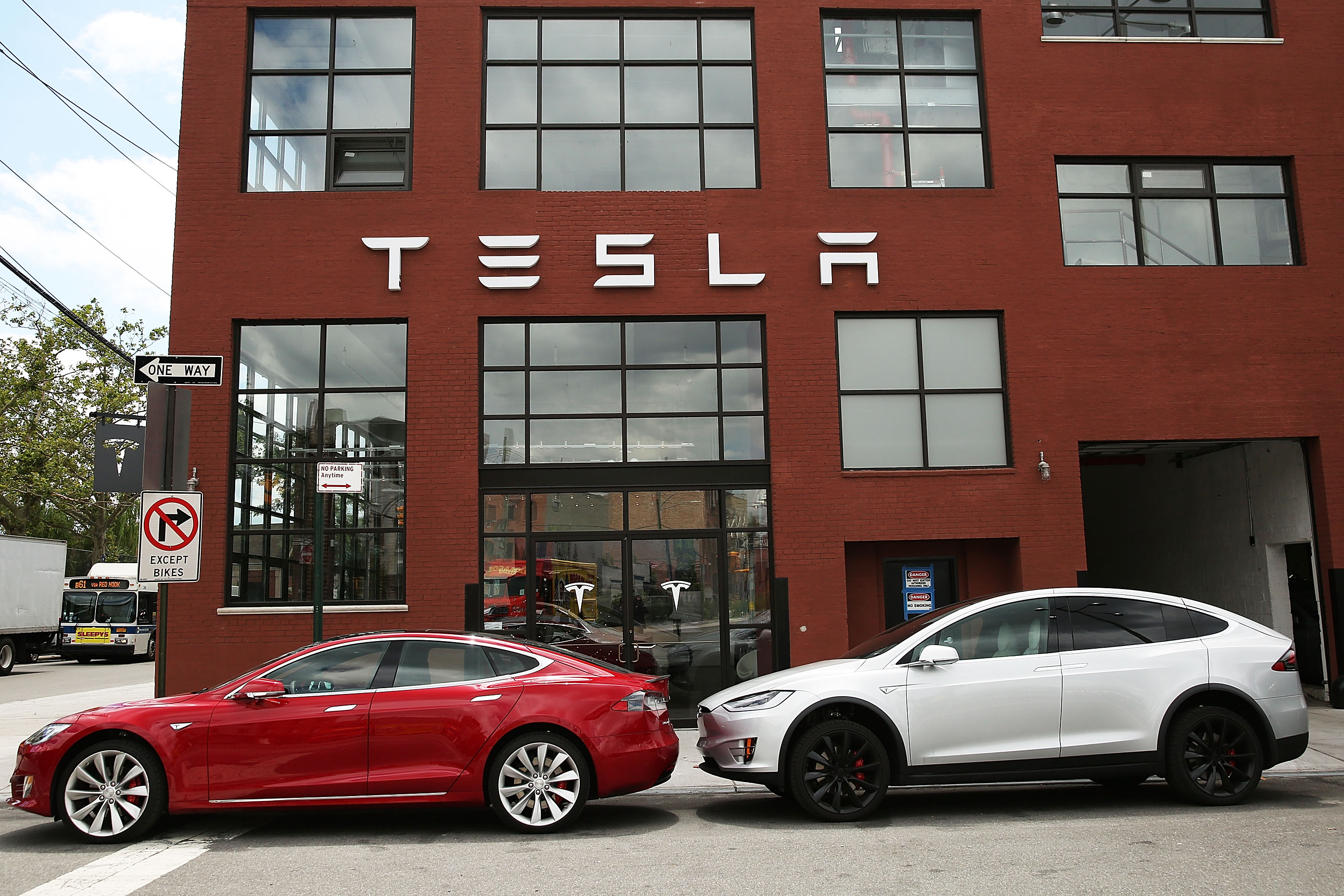 In this file photo, Tesla vehicles sit parked outside of a new Tesla showroom and service center in Red Hook, Brooklyn on July 5, 2016 in New York City.