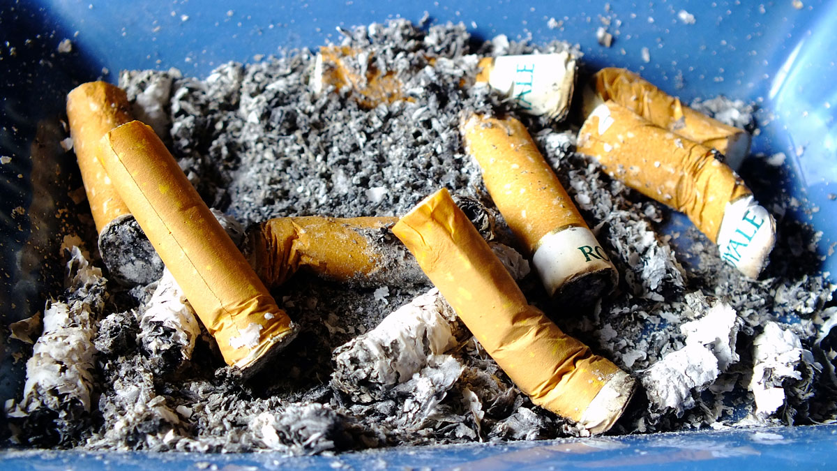Ashtray, Filled with cigarette stubs.