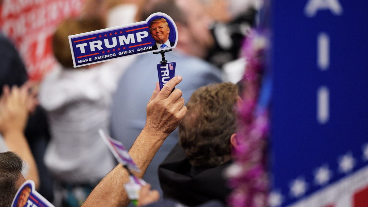 Delegates hold up stickers in support of Republican presidential candidate Donald Trump on the third day of the Republican National Convention on July 20, 2016, at the Quicken Loans Arena in Cleveland, Ohio.