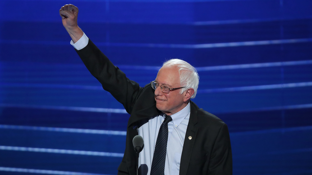 Sen. Bernie Sanders acknowledges the crowd before delivering remarks on the first day of the Democratic National Convention at the Wells Fargo Center, July 25, 2016 in Philadelphia, Pennsylvania. Sanders is urging his supporters to back Hillary Clinton in the general election.