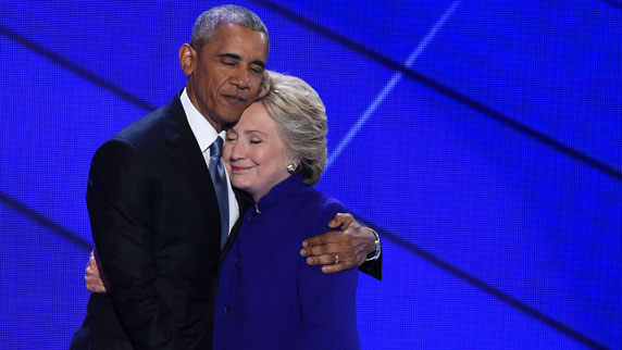 U.S. President Barack Obama and Democratic presidential nominee Hillary Clinton embrace onstage during day three of the Democratic National Convention on July 27, 2016 in Philadelphia, Pennsylvania.