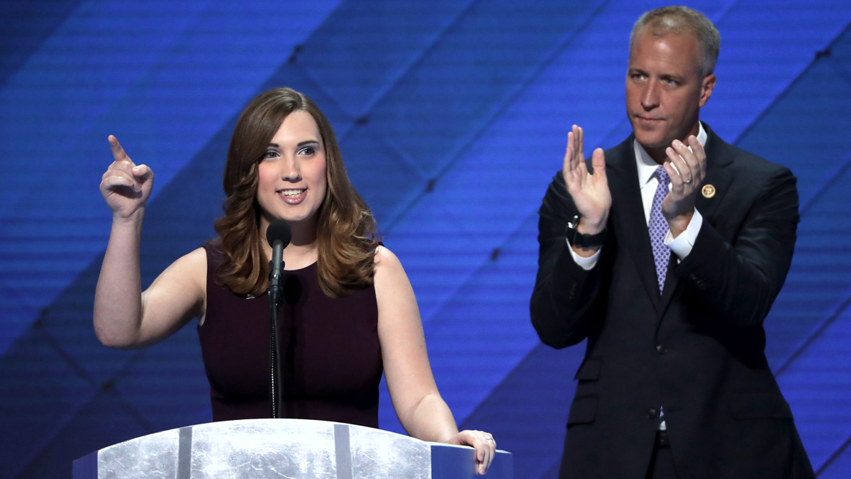 LGBT rights activist Sarah McBride delivers remarks as Co-Chair of the Congressional LGBT Equality Caucus Congressman Sean Patrick Maloney looks on during the fourth day of the Democratic National Convention at the Wells Fargo Center, July 28, 2016 in Philadelphia, Pennsylvania.