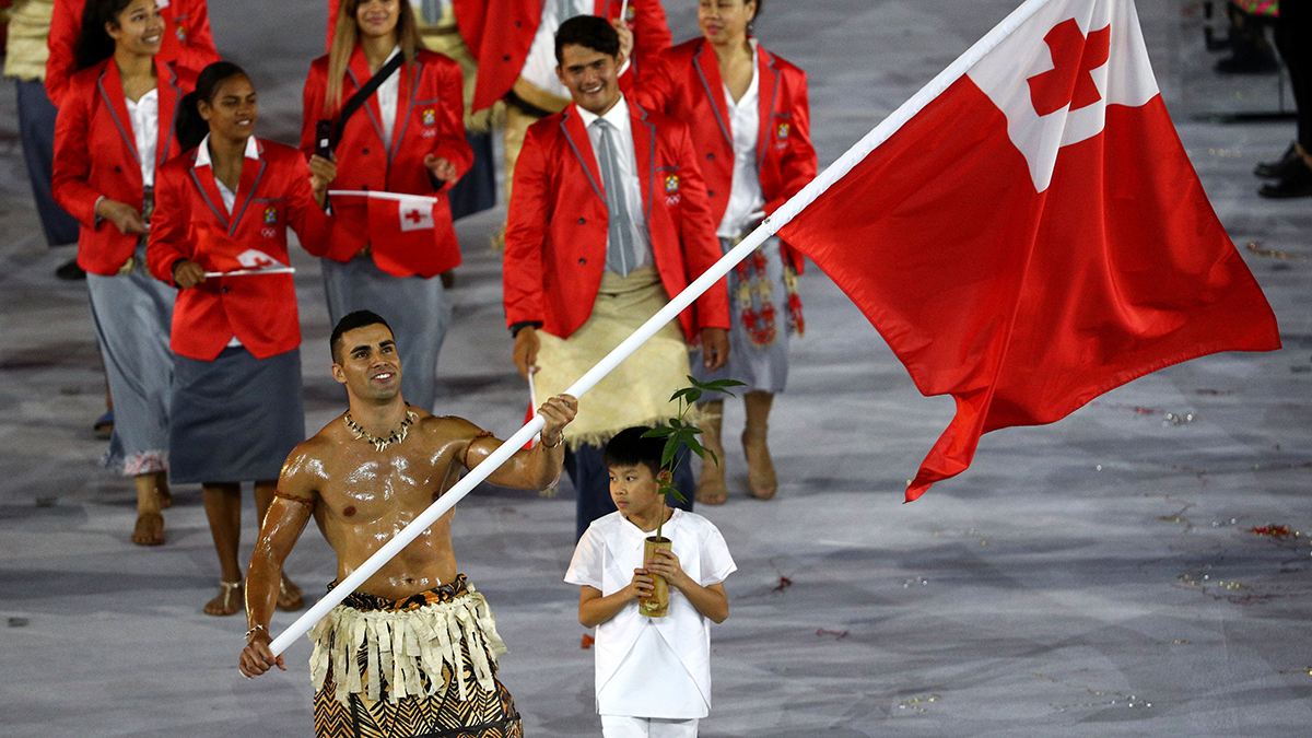 Flag bearer Pita Nikolas Taufatofua of Tonga leads his Olympic Team during the Opening Ceremony of the Rio 2016 Olympic Games at Maracana Stadium on August 5, 2016 in Rio de Janeiro, Brazil.