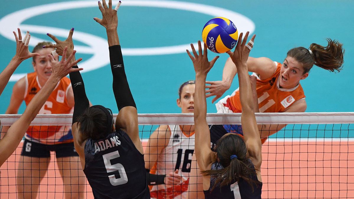 Netherlands' Anne Buijs (R) plays a shot during the women's qualifying volleyball match between the USA and the Netherlands at the Maracanazinho stadium in Rio de Janeiro on Aug. 8, 2016, during the 2016 Rio Olympics