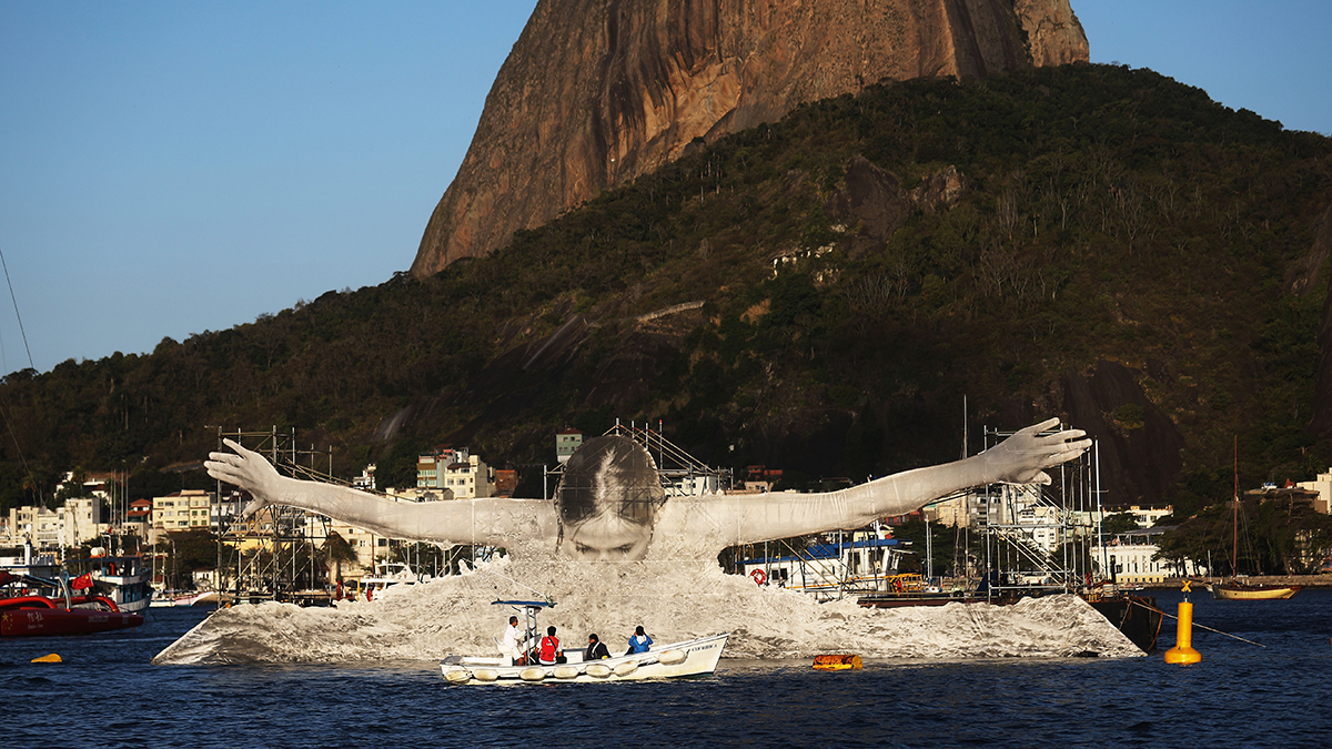 RIO DE JANEIRO, BRAZIL - AUGUST 13: An installation by French artist JR displays a swimmer in Guanabara Bay in front of Sugarloaf Mountain during the Rio 2016 Olympic Games on August 13, 2016 in Rio de Janeiro, Brazil. The artist has installed a number of Olympic-related installations around the city. (Photo by Mario Tama/Getty Images)