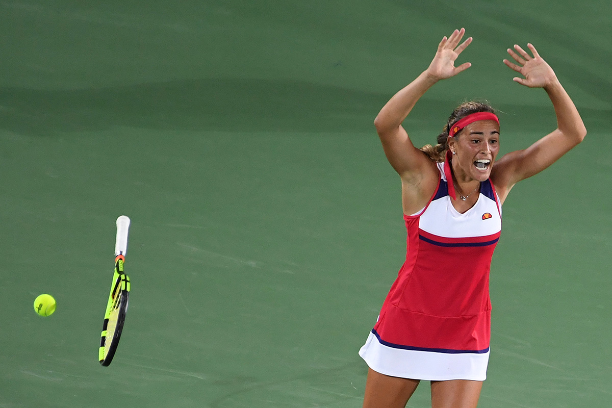 Puerto Rico's Monica Puig reacts after winning the women's singles tennis gold on August 13, 2016.