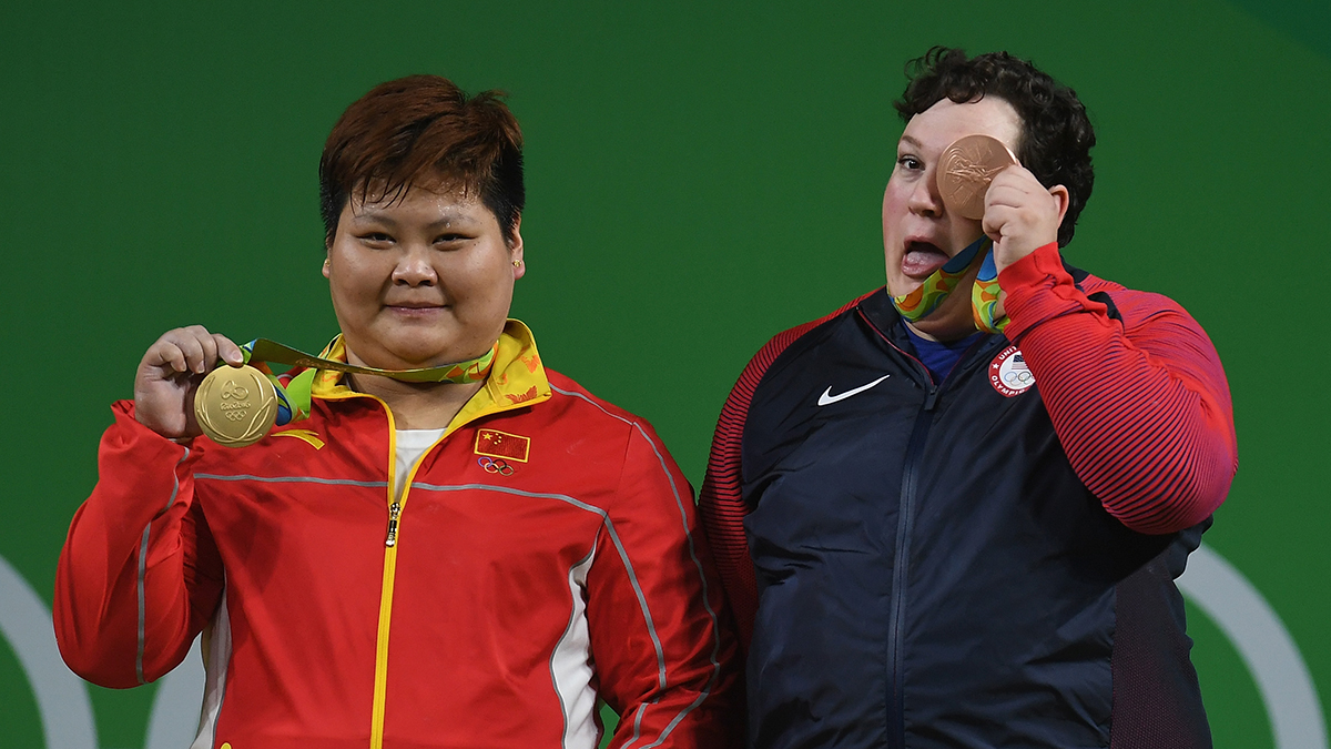 Gold medalist Suping Meng of China and bronze medalist Sarah Elizabeth Robles of the United States pose on the podium during the medal ceremony for the Weightlifting - Women's +75kg Group A on Day 9 of the Rio 2016 Olympic Games at Riocentro - Pavilion 2 on August 14, 2016 in Rio de Janeiro, Brazil.