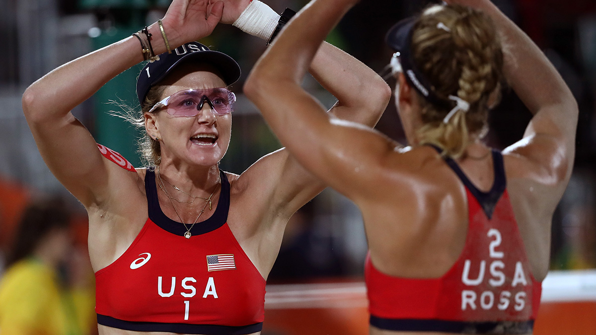 Kerri Walsh Jennings (L) of United States celebrates with teammate April Ross during a Women's Quarterfinal match between the United States and Australia on Day 9 of the Rio 2016 Olympic Games on Aug. 14, 2016 in Rio de Janeiro, Brazil.