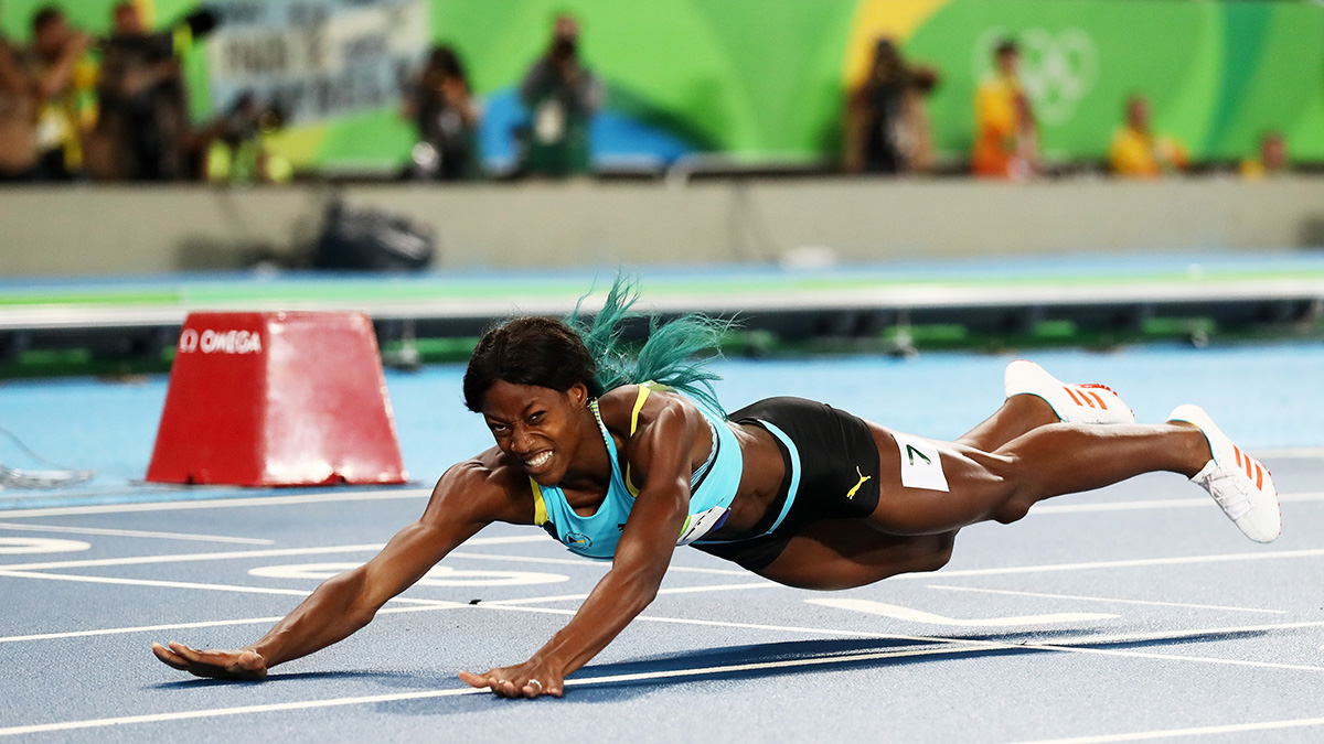 Shaunae Miller of the Bahamas dives over the finish line to win the gold medal in the Women's 400m Final on Day 10 of the Rio 2016 Olympic Games on Aug. 15, 2016 in Rio de Janeiro, Brazil.