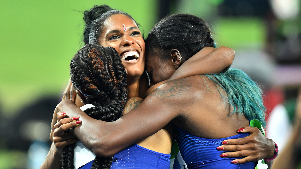 Gold medalist Brianna Rollins, left, silver medallist Nia Ali, right, and bronze medallist Kristi Castlin celebrate after completing a U.S. sweep of the women's 100m at the Rio 2016 Olympic Games at the Olympic Stadium in Rio de Janeiro on Aug. 17, 2016.
