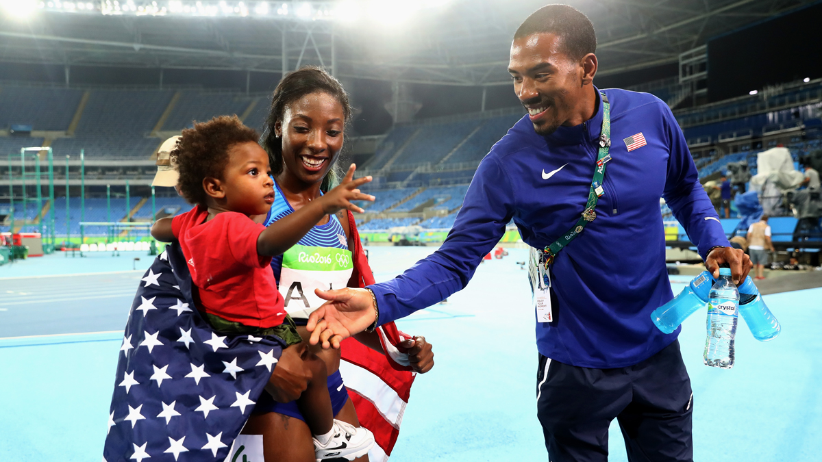 Silver medalist Nia Ali of the United States holds her son Titus as gold medalist Christian Taylor of the United States tries to shake his hand on Day 12 of the Rio 2016 Olympic Games at the Olympic Stadium on Aug. 17, 2016, in Rio de Janeiro, Brazil.