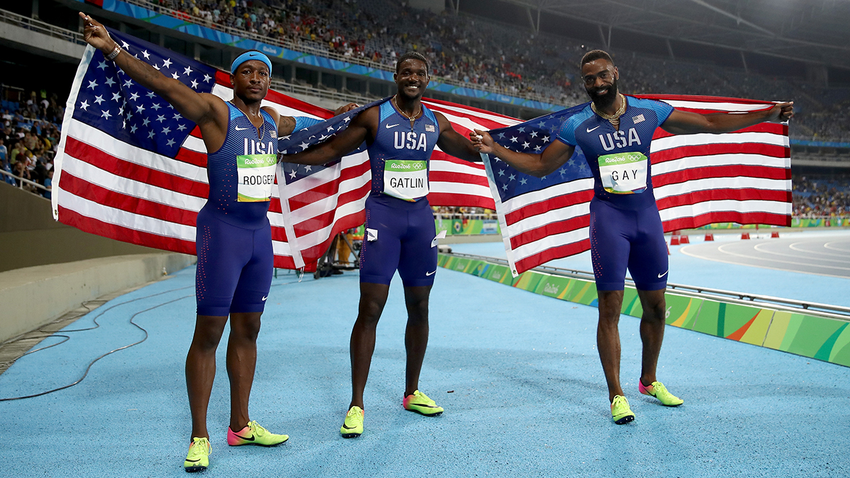 RIO DE JANEIRO, BRAZIL - AUGUST 19: Mike Rodgers, Justin Gatlin and Tyson Gay of the United States celebrate prior to being disqualified after the Men's 4 x 100m Relay Final on Day 14 of the Rio 2016 Olympic Games at the Olympic Stadium on August 19, 2016 in Rio de Janeiro, Brazil. (Photo by Cameron Spencer/Getty Images)