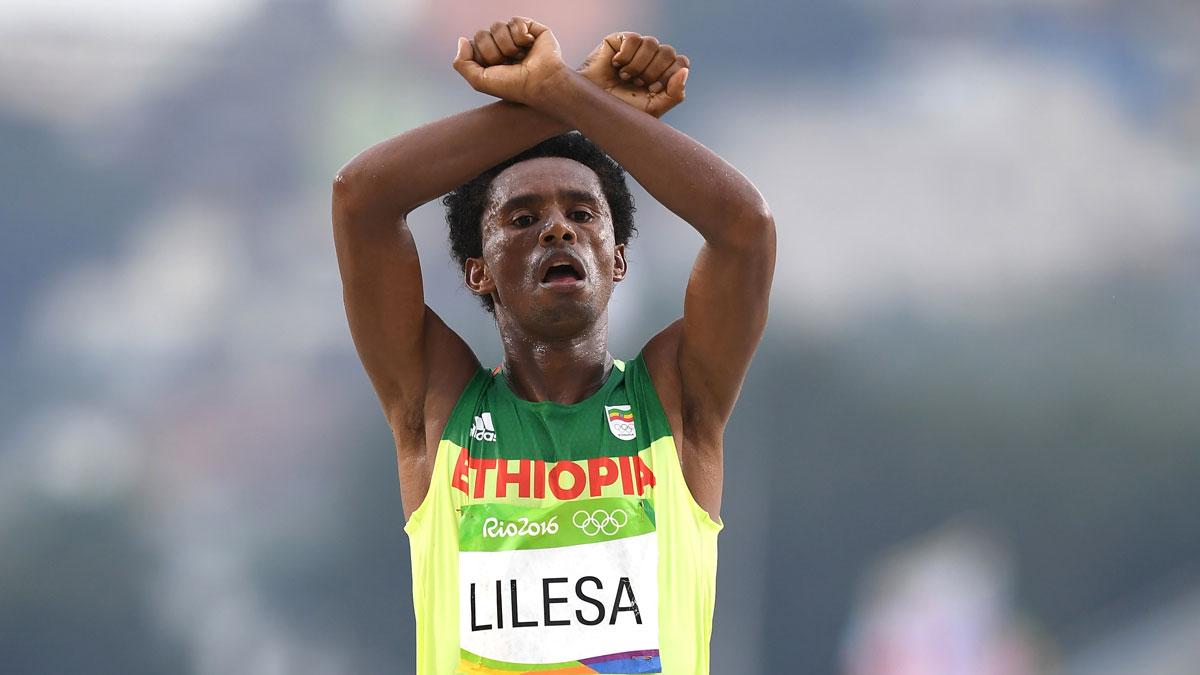 Feyisa Lilesa of Ethiopia pictures as he crosses the line to win silver during the Men's Marathon on Day 16 of the Rio 2016 Olympic Games at Sambodromo on Aug. 21, 2016, in Rio de Janeiro, Brazil.