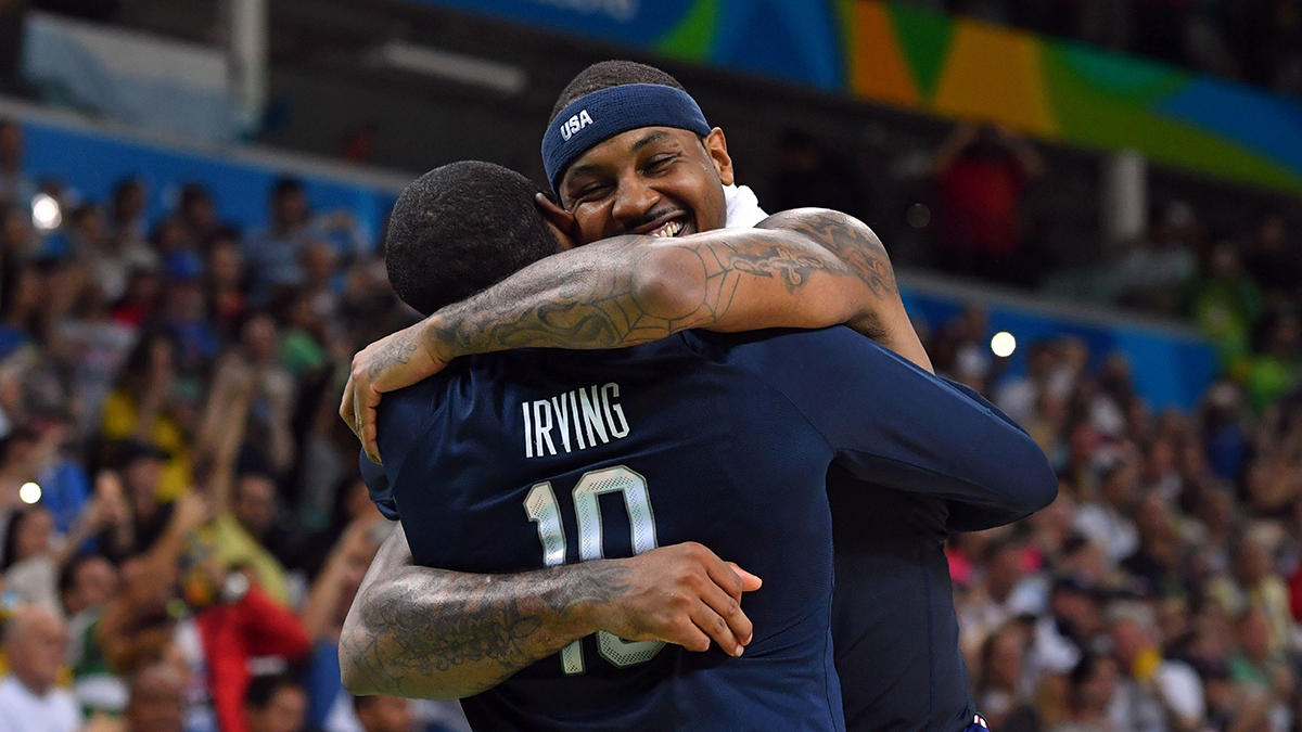 USA's forward Carmelo Anthony (right) embraces USA's guard Kyrie Irving after USA defeated Serbia during a Men's Gold medal basketball match between Serbia and USA at the Carioca Arena 1 in Rio de Janeiro on Aug. 21, 2016, during the Rio 2016 Olympic Games.