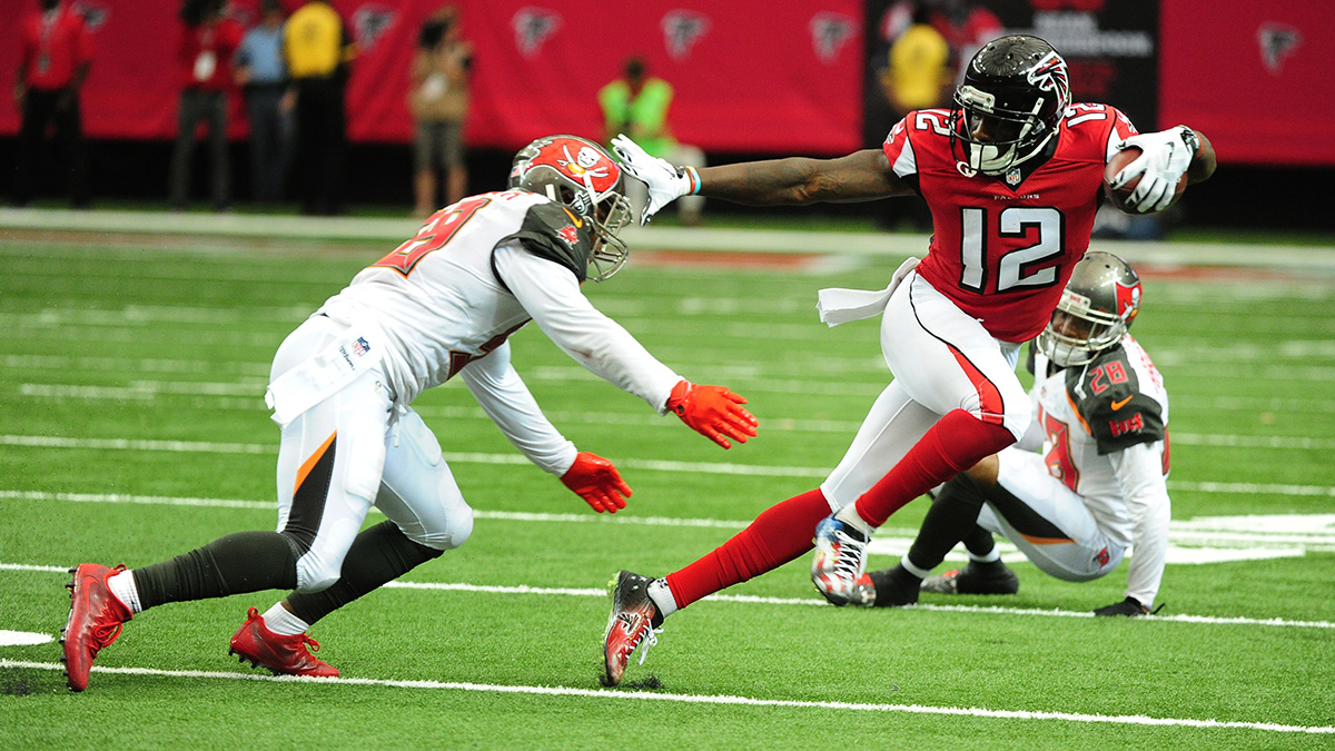 ATLANTA, GA - SEPTEMBER 11: Muhamed Sanu #12 of the Atlanta Falcons eludes the tackle attempt by Kwon Alexander #58 of the Tampa Bay Buccaneers at the Georgia Dome on September 11, 2016 in Atlanta, Georgia. (Photo by Scott Cunningham/Getty Images)