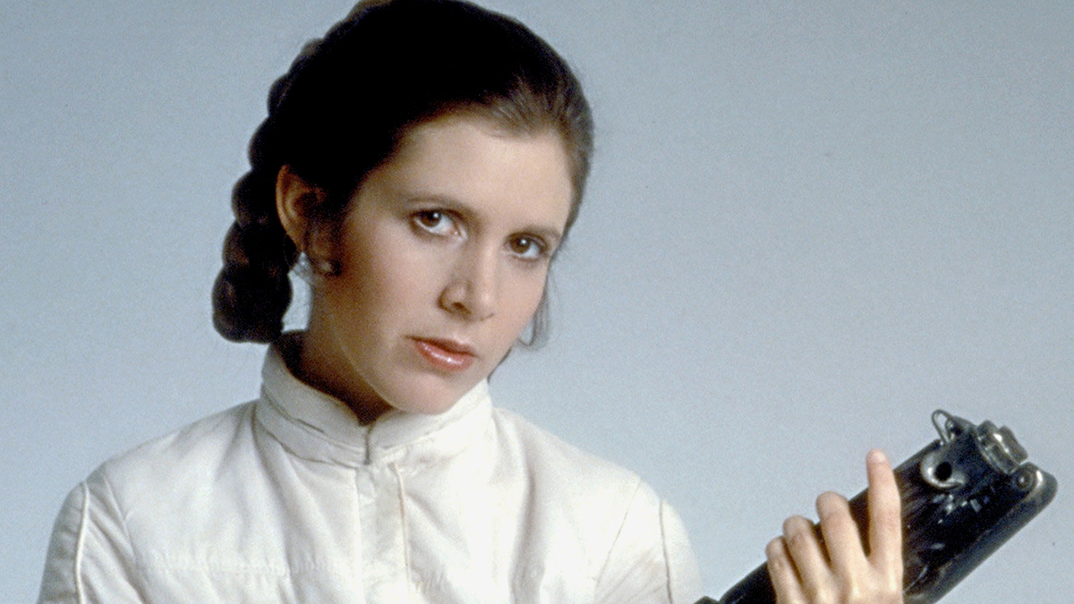 Actress Carrie Fisher pose in costume as Princess Leia on the set of