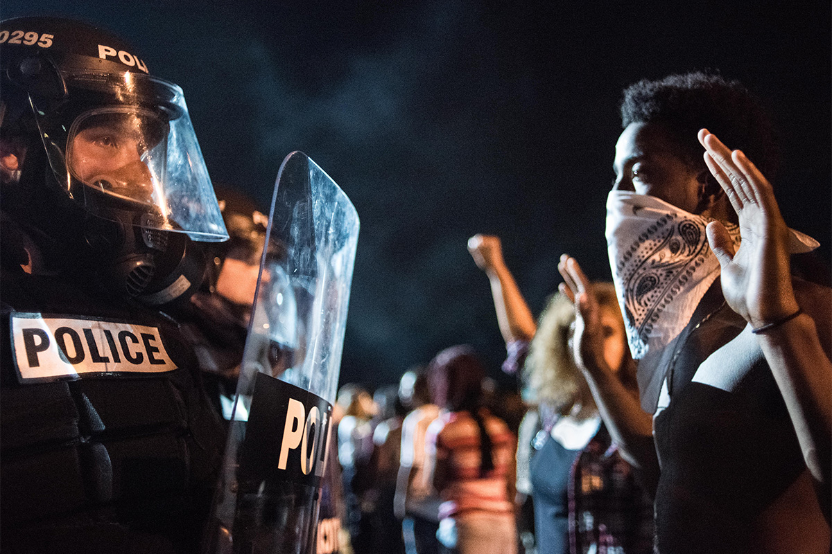 In this Sept. 21, 2016, file photo, police officers face off with protestors during protests following the death of a man shot by a police officer in Charlotte, North Carolina. States' participation in the Department of Justice's pilot program to collect data on police use of force is voluntary, and they have been reluctant to share such data in the past.