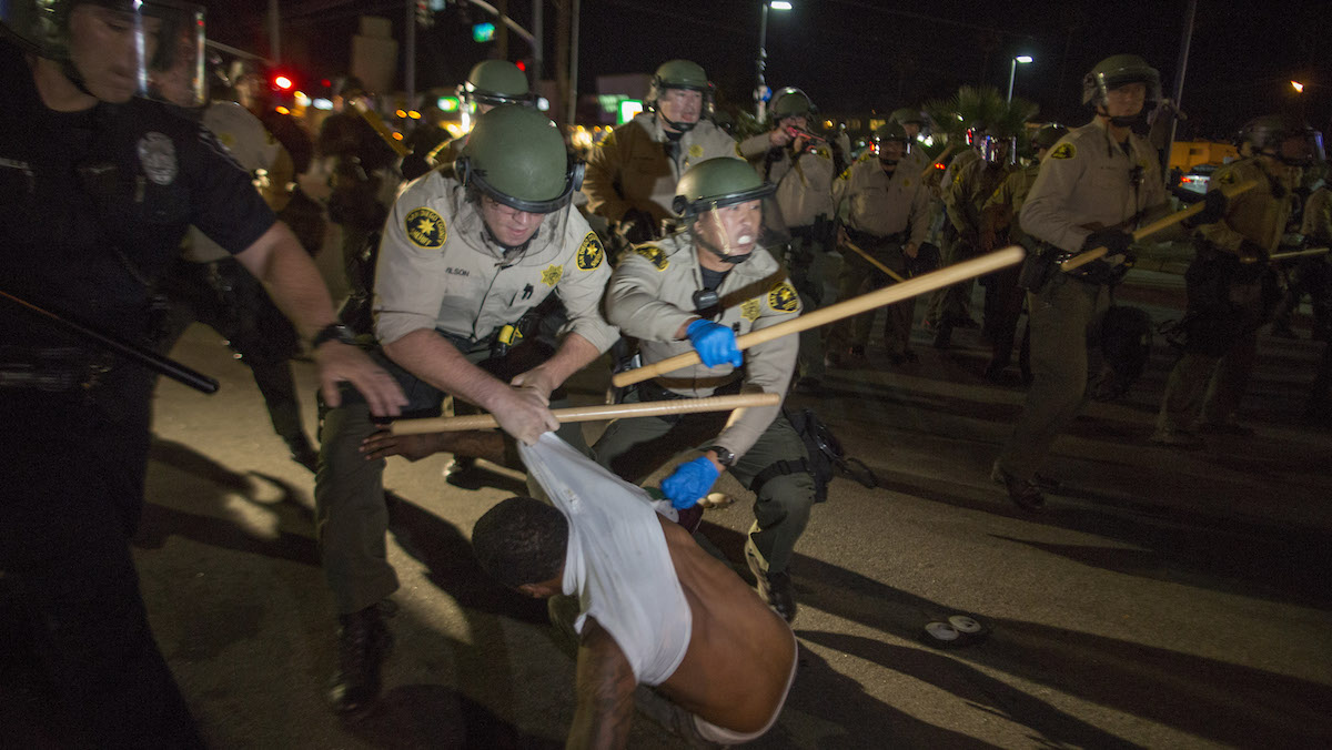 Police arrest a protester who tried to stand his ground after an unlawful assembly was declared on a street near the site where an unarmed black man, Alfred Olango, 38, had been shot by police earlier this week on September 29, 2016 in El Cajon, California.