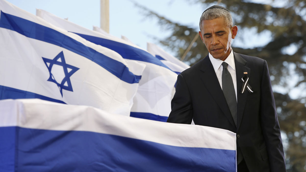 President Barack Obama touches the coffin of Shimon Peres after delivering his eulogy during the funeral at Mount Herzl Cemetery on Sept. 30, 2016, in Jerusalem, Israel. World leaders and dignitaries from 70 countries attended tthe state funeral of Israel's ninth president, Shimon Peres, in Jerusalem on Friday, after thousands of Israelis paid their last respects to the elder statesman who died on Wednesday.
