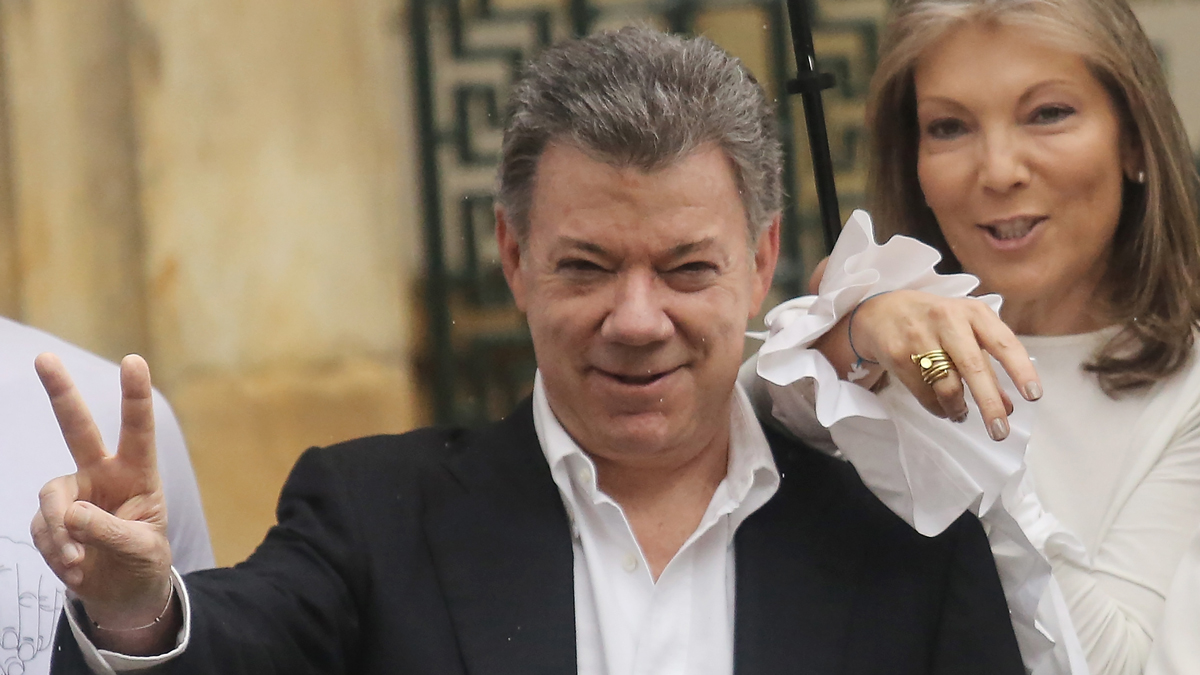 Colombia's President Juan Manuel Santos makes the victory/peace sign with wife Maria Clemencia Rodriguez after voting in the referendum on a peace accord to end the decades-old guerrilla war between the FARC and the state on Oct. 2, 2016, in Bogota, Colombia. Santos won the 2016 Nobel Peace Prize