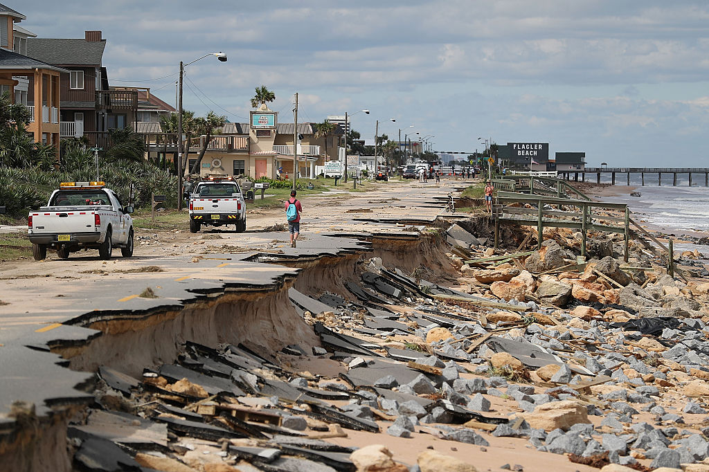 FLAGLER BEACH, FL - OCTOBER 08: A1A is seen after ocean waters stirred up by Hurricane Matthew washed away part of the ocean front road on October 8, 2016 in Flagler Beach, Florida. Across the Southeast, Over 1.4 million people have lost power due to Hurricane Matthew which has been downgraded to a category 1 hurricane on Saturday morning. (Photo by Joe Raedle/Getty Images)