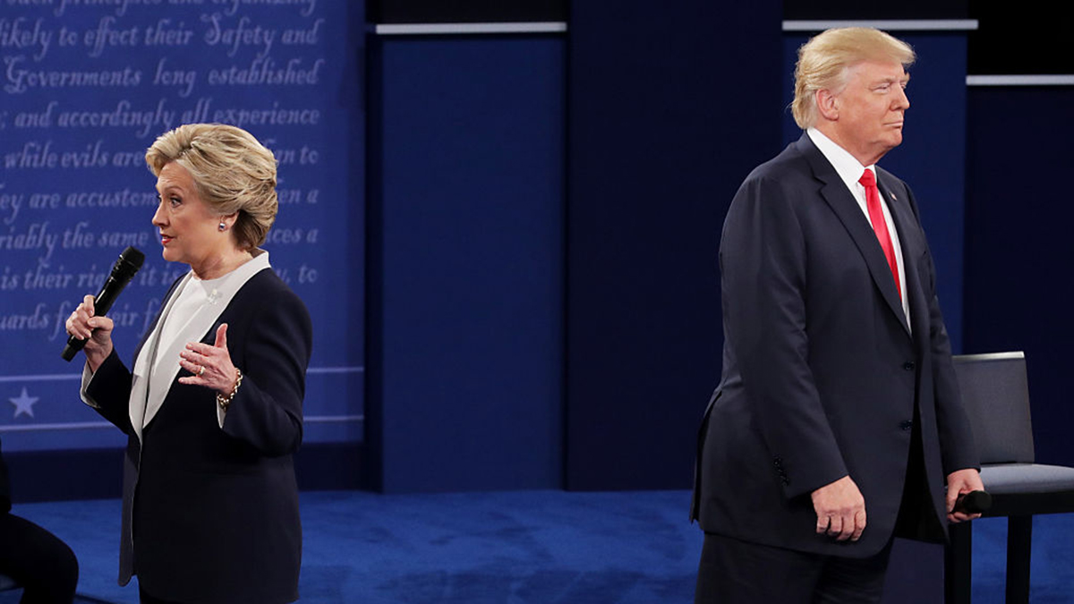 Hillary Clinton speaks as Donald Trump looks on during the town hall presidential debate at Washington University on Sunday, October 9, 2016, in St Louis, Missouri. A new NBC News / WSJ poll conducted after the debate found Clinton maintained a nine-point lead over her opponent in a four-way match-up.