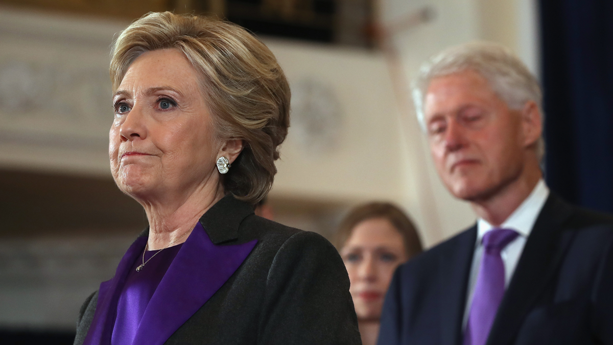 Former Secretary of State Hillary Clinton, accompanied by her husband former President Bill Clinton, pauses as she concedes the presidential election at the New Yorker Hotel on Nov. 9, 2016, in New York City. Republican candidate Donald Trump won the 2016 presidential election in the early hours of the morning in a widely unforeseen upset.