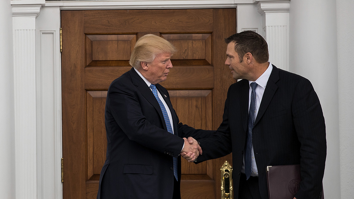 President-elect Donald Trump and Kris Kobach shake hands following their meeting at Trump International Golf Club, Nov. 20, 2016, in Bedminster Township, N.J.