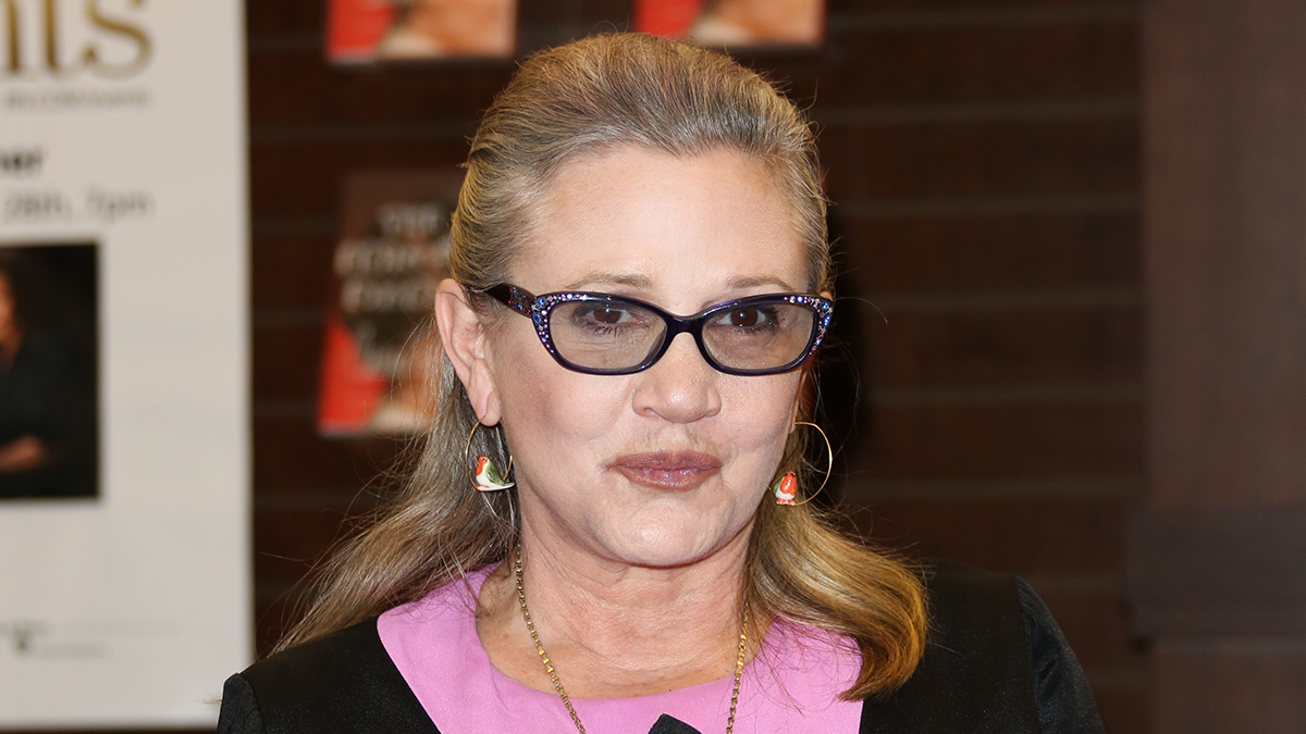 Actress Carrie Fisher signs copies of her new book