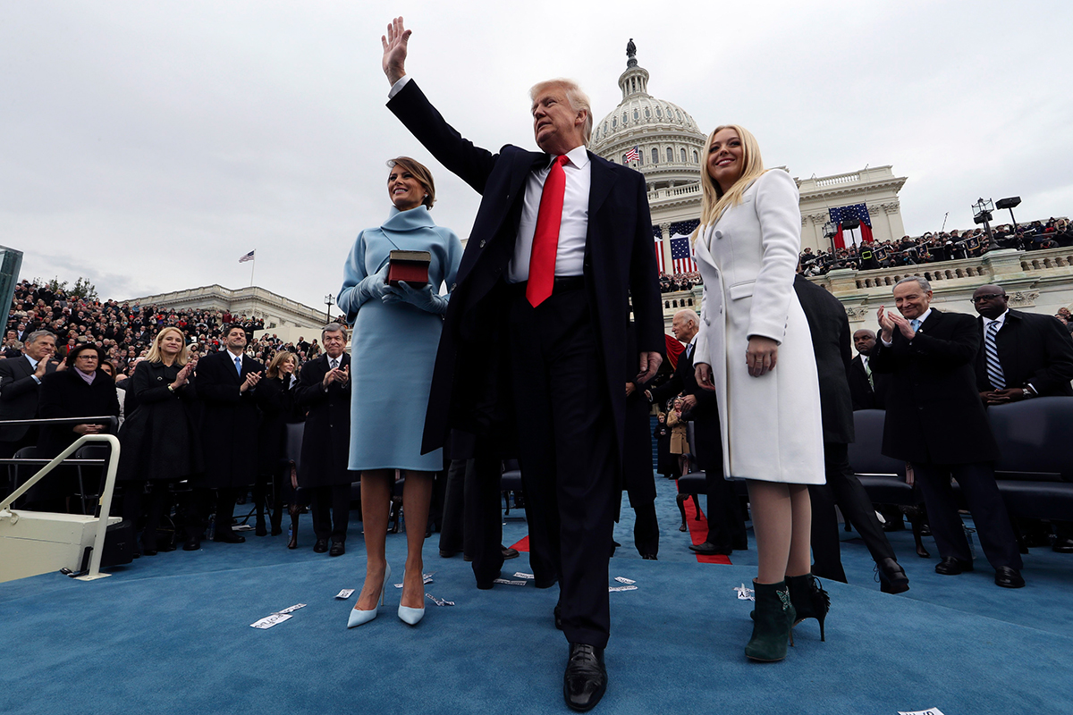 U.S. President Donald Trump acknowledges the audience after taking the oath of office as his wife Melania, left, and daughter Tiffany watch during inauguration ceremonies swearing in Trump as the 45th president of the United States on the West front of the U.S. Capitol in Washington, DC. Jan. 20, 2017.