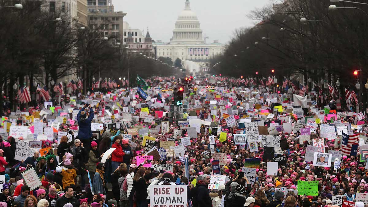 In this file photo, protesters walk during the Women's March on Washington, with the U.S. Capitol in the background, on Jan. 21, 2017. Large crowds are attending the anti-Trump rally a day after Donald Trump was sworn in as the 45th president.