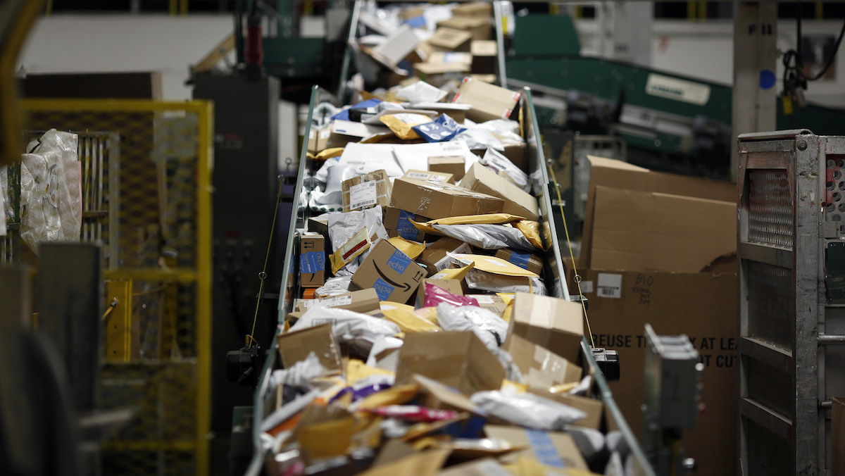 In this file photo, parcels move along a conveyor belt at the United States Postal Service (USPS) sorting center in Louisville, Kentucky, on Friday, Jan. 13, 2017.