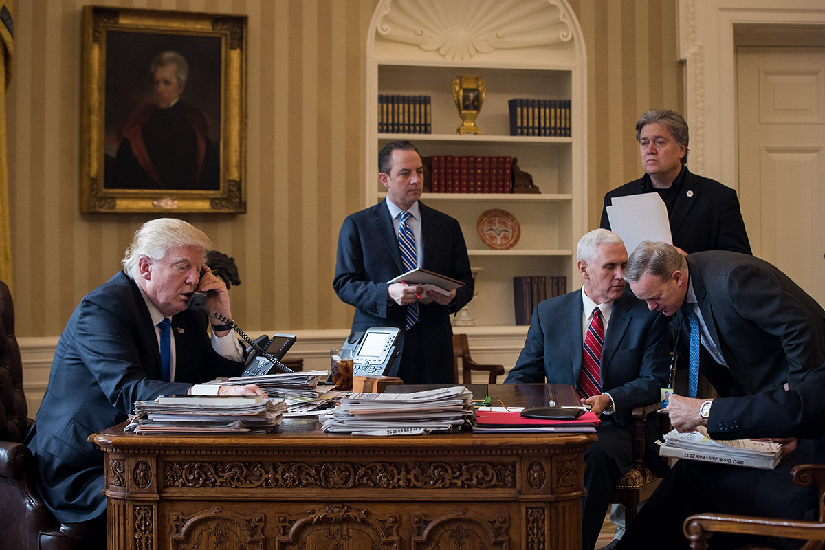 President Donald Trump speaks on the phone with Russian President Vladimir Putin in the Oval Office of the White House, January 28, 2017 in Washington, D.C. Also pictured, from left, White House Chief of Staff Reince Priebus, Vice President Mike Pence, White House Chief Strategist Steve Bannon, and Press Secretary Sean Spicer.