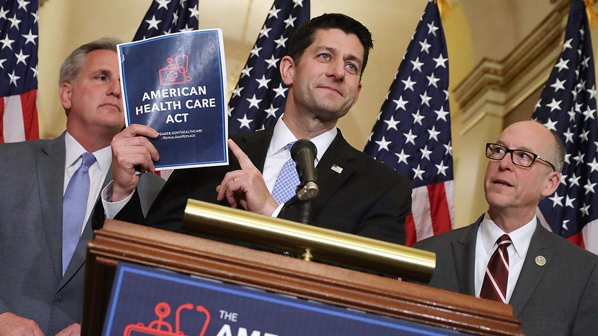 This March 7, 2017, file photo shows Speaker of the House Paul Ryan holding up a copy of the American Health Care Act during a news conference with House Majority Leader Kevin McCarthy, at left, and House Energy and Commerce Committee Chairman Greg Walden at right, outside Ryan's office in the U.S. Capitol in Washington, D.C.