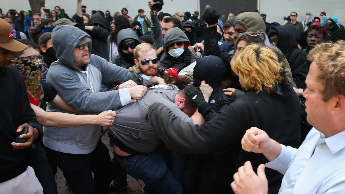 Trump supporters clash with protesters at a