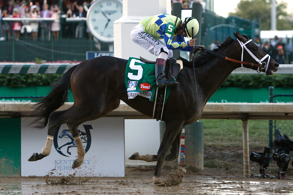 Jockey John Velazquez celebrates as he guides Always Dreaming #5 across the finish line to win the 143rd running of the Kentucky Derby at Churchill Downs on May 6, 2017, in Louisville, Kentucky.